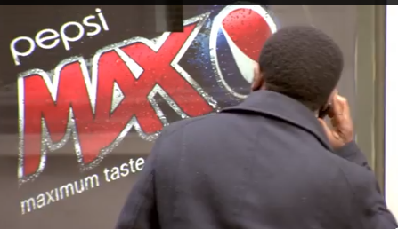Man looks at Pepsi Max Advert at Bus Stop